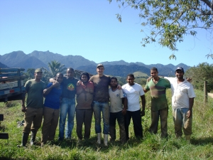 Peter Slovak harvesting manioc with local farm workers